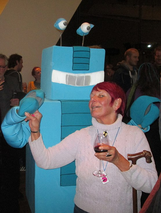 Mr KLIKbot enjoying the opening party with Nancy