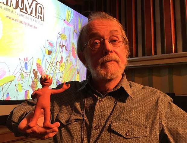 Peter Lord listens while Morph explains