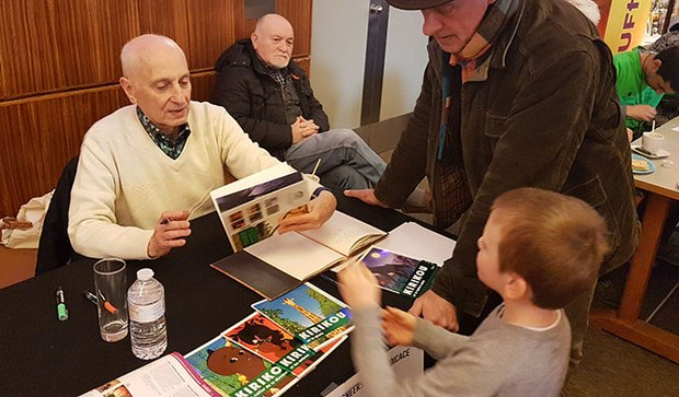 Michel Ocelot signing DVD's for a young fan