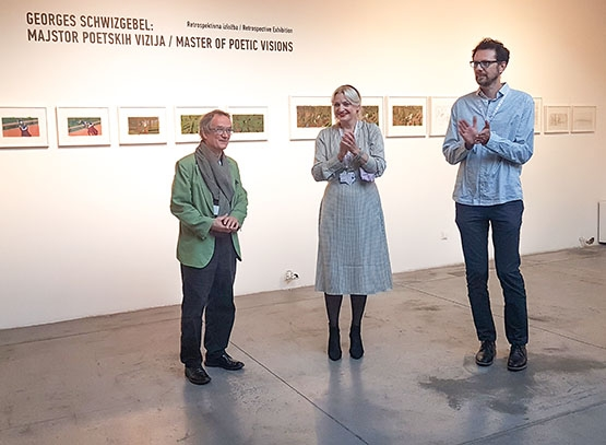 Georges Schwizgebel at his exhibition with Paola Orlic and Daniel Suljic
