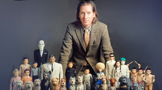 Wes Anderson with puppets from Isle of Dogs