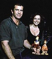 Screen star Mel Gibson holds his alter-ego Rocky, while Julia Sawalha holds her alter-ego Ginger. TM & © 1998 DreamWorks LLC.