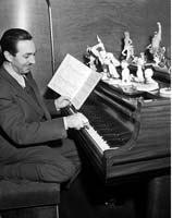 Walt Disney at the piano.