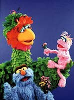 Abelardo (green), Lola (pink), and Pancho Contreras (blue) in the Mexican co-productionPlaza Sesamo. © CTW. Sesame Street Muppets © Henson.