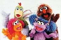 Dafi (purple), Oofnik (brown), Haneen (orange), and Kareem (rooster) in the Israeli/Palestinian co-production Rechov Sumsum/Shara'a Sumsum. © CTW. Sesame Street Muppets © Henson.