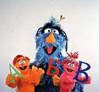 Zeliboba, Busya, and Kubik in the Russian co-production Ulitsa Sezam.© CTW. Sesame Street Muppets © Henson.