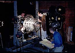 Left to right: Con Pederson, Douglas Trumball, and Benjamin Jackson working with a multi-plane apparatus for Graphic Films' To the Moon and Beyond. Photo courtesy of Graphic Films.