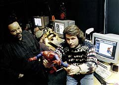 Kleiser-Walczak Technical Supervisor Jeffery A. Williams and Lead Animator Derald Hunt use an action figure to analyze Spider-Man's movement. Image courtesy of Kleiser-Walczak Construction Company.