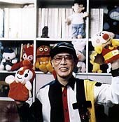 Mr. Yanase at the Museum surrounded by his beloved and financially-rewarding pals. © Yanase Studio, 1999.