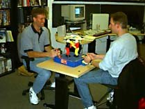Though their office is crammed with toys, LucasArts writer-animator Larry Ahern and programmer-writer Jonathan Ackley are hardly the image of goofy post-adolescent wunderkinds. © LucasArts.