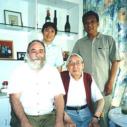 Te Wei at home (seated right), next to author Dr. John A. Lent, with co-author Xu Ying (standing left) and critic Chen Jian Yao, last year in Shanghai, China. Photo courtesy of Dr. John A. Lent.