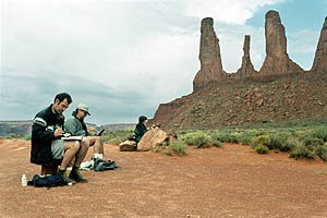 Production designer Kathy Altieri (far right) and art directors Luc Desmarchelier (left) and Ron Lukas sketch the unique rock formations of Monument Valley, which served as the site of the cavalry fort in the movie.