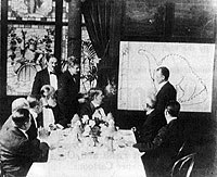 Animation pioneer Winsor McCay draws Gertie the Dinosaur for a group in this undated photo.