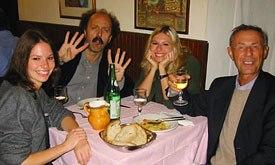 Bruno Bozzetto (right) and conductor Roberto Frattini dine with Bozzetto's daughters, Irene (left) and Anita.
