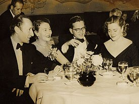 The CIA used Howard Hunt and his Hollywood contacts to obtain film rights to Animal Farm from Sonia Orwell. Here, Mrs. Orwell is seen dining with (left to right) Halas, Batchelor and Bordon Mace, president of the company which produced Anim