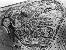 Does he look like an evil emperor to you? Here Uncle Walt shows off the master plan for Disneyland. © Disneyland.