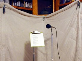 Sound-dampening in the corner of an office that is being used for recording. Notice that the actors will be facing the hanging blankets.