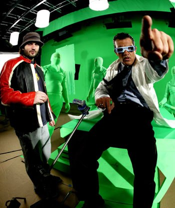 Director Robert Rodriguez and actor Antonio Banderas, making a point on the green screen shooting stage.
