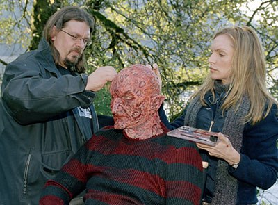 Robert Englund (seated) has his make-up touched up during a break.