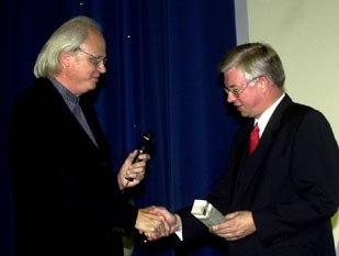 Dennis Muren (left) is greeted by Hessen Prime Minister Roland Koch.