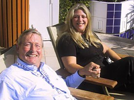 Sarah Baisley interviews ceo of Millimages U.K. Jonathan Peel in typical MIPCOM Jr. fashion, poolside at the Martinez. . © AWN.