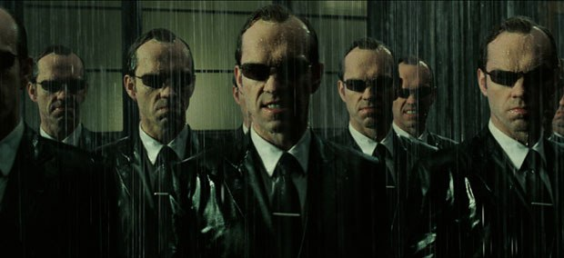 Many Agent Smiths appear courtesy of CG in The Matrix Revolutions. © 2003 Warner Bros. Ent.  U.S., Canada, Bahamas & Bermuda. ©2003 Village Roadshow Films (BVI) Ltd  All other territories (All rights reserved used by perm