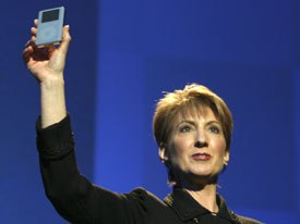 Carly Fiorina, chairman/ceo of HP, introduces the new HP Digital Music Player, based on the Apple iPod design.
