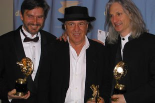 The Last Samurai team scored outstanding supporting visual effects in a motion picture. Receiving the award were (left to right) Ray McIntyre, Jr., Bill Mesa and Jeffrey A. Okun. The other team member Thomas Boland was not present.