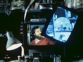 A TV haunts a man trapped inside a Moviola in Media.