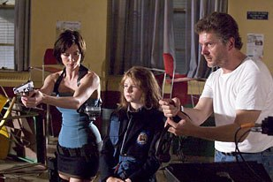 Director Alexander Witt (right) shows actresses Sienna Guillory and Sophie Vavasseur how its done. Photo by Rolf Konow.