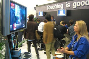 Woman Magnet: Donkey Kong Jungle Beat had female gamers lined up at the Nintendo booth to try out a pair of bongo drums with a small microphone between them, interfaced with a scrolling game. Photo credit: Chris Harz.