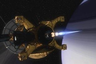 Cassini firing its main thruster above Saturns rings to enter Saturns orbit.