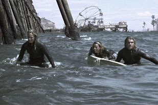 Z-Boys Stacy, Tony and Jay surf off Venice's burnt out Pacific Ocean Pier in the films opening. The pier, Ferris wheel and beachfront buildings were created by Gray Matter FX.