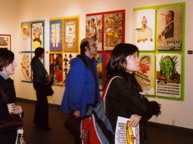 Attendees of The Masters Series: Heinz Edelmann exhibition at School of Visual Arts view the artists work.