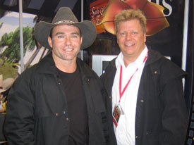 Whip Cracking Prods. gm Phil Bradsheet (right) came all the way from Australia to promote the series Action Dann's Outback Adventures, starring Troy Dann.