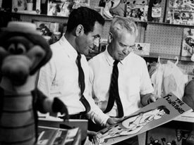 Joe Barbera and Bill Hanna inspect a drawing of Fred Flintstone. Image courtesy of Warner Bros. Animation.