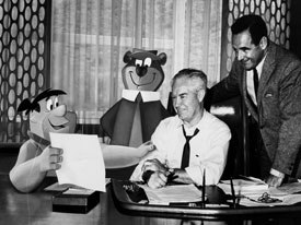 Joe Barbera and Bill Hanna have a meeting with their alter egos Yogi and Fred. Image courtesy of Warner Bros. Animation.
