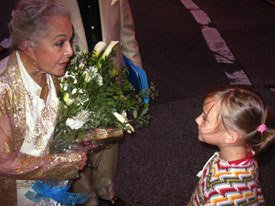 Marge Champion, the reference model for Snow White, is charmed by Ava Jenkins.