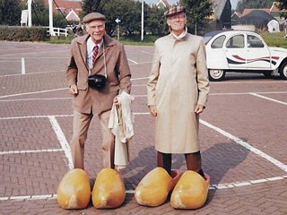 Ollie (left) and Frank try on some new shoes in Denmark. Courtesy of Hans Perk.