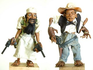 Darren Way carved his Bin Laden (l) and Bush puppets out of choice pieces of found local hardwood. They are finished with olive oil to give a flesh-like appearance. Each figure took two full 50-hour weeks to carve.