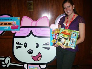 Emily Schaeff, senior product marketing manager for Brighter Minds Media, shows off some of the new titles and products that the company is creating for DreamWorks and Marvel Comics. Courtesy of Donna Bulford.