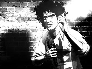 Morgen used a hard keylight to create a dramatic rendering effect in a scene where Abbie Hoffman is performing in a club, but was unable to duplicate the look in the courtroom scenes.