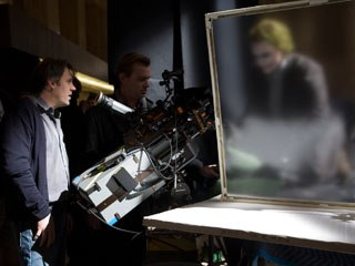 Cinematographer Wally Pfister with director Christopher Nolan (center) photograph Heath Ledger with the IMAX camera. Photo credit: Stephen Vaughan.