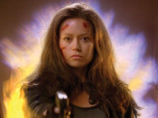 Cameron (Summer Glau) is comped over flames in a doorway in the season two premiere
