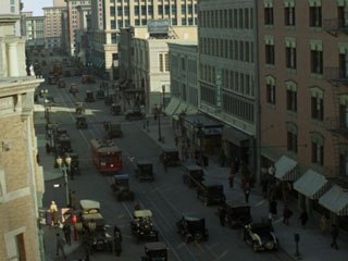 In a quintessential shot, the camera looks down a busy downtown street. The shot began with live-action extras, which appear in about the first minute of the shot, and eventually go to all-digital extras.