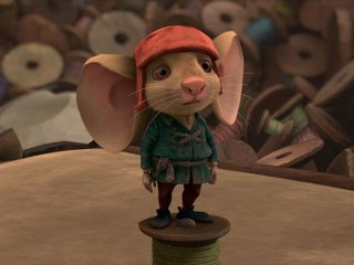 Despereaux surrounded by the muted colors and soft light of Hovis' Lair.