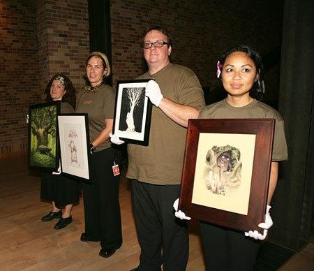 Volunteers present the art work that's up for bidding. (Photo by Deborah Coleman / Pixar)