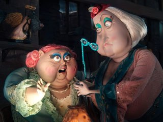 Miss Forcible and Miss Spink are startled by a tea leaf reading. Their Other World counterparts, like all of Coraline's neighbors, are more grand versions of their