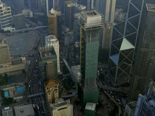 A 60-story unfinished skyscraper had to be created via CGI and dropped into the middle of downtown Hong Kong.