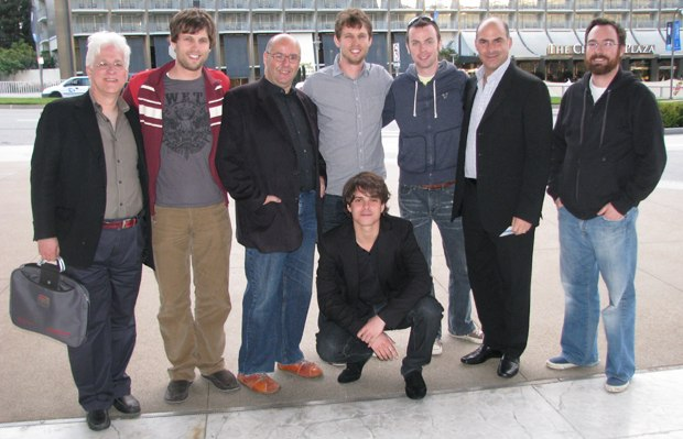 The tour poses for a picture with CAA client Jon Heder (c).